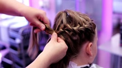 Hairstyle. binding up braids - stock footage