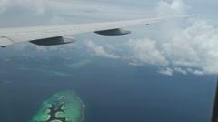 Maldives Islands aerial view from plane window. Stock Footage