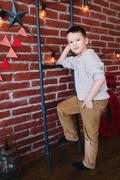Boy in a loft studio - stock photo