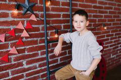 Boy in a loft studio Stock Photos