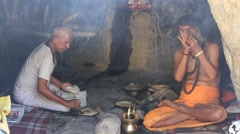Two Indian sadhu (holy man) in the holy cave near the Ganges river. India Stock Footage