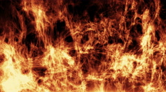 igniting fire isolated on black background. - stock footage