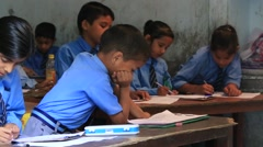Indian girls and boys in a local school during the lesson . India Stock Footage
