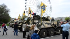 """Flags of the regiment """"Azov"""" by military vehicles. People around. - stock footage"""