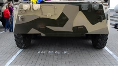 Armored personnel carrier and people around. - stock footage