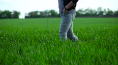 Girl goes on the field of wheat Stock Footage