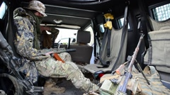 The soldier with the automatic weapon in the jeep.  Stock Footage