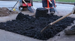 Laying Asphalt In A Pothole Stock Footage