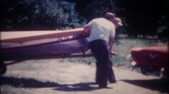 3288 men hook up the boat trailer to the family car - vintage film home movie Stock Footage