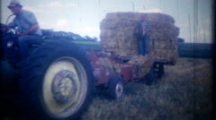 3286 father & son bring in the hay harvest from fields - vintage film home movie Stock Footage