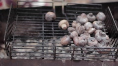 Grilling zucchinis and champignon mushrooms Stock Footage