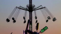 Fairground attractions at sunset. Stock Footage