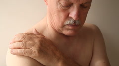 Senior man with pain in his shoulder Stock Footage