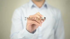 Immigration , Man writing on transparent screen Stock Footage