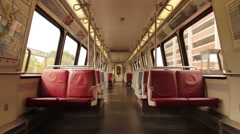 Empty Metro car in Washington DC stops at station and passengers get on Stock Footage