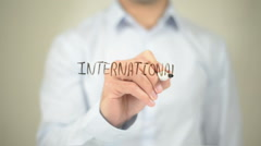 International , Man writing on transparent screen Stock Footage