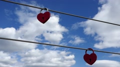STOCKHOLM, SWEDEN, MAY 2016: Shaky Love locks with sky and clouds background Stock Footage
