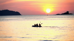 People kayaking on sea during sunset, super slow motion 240fps Stock Footage