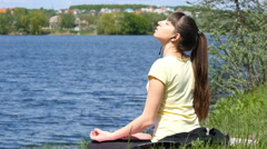 Young woman removing his jacket enjoying sun and warmth. - stock footage