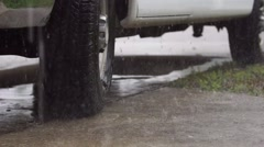 Car Tire Close Up in a Rain Storm Stock Footage