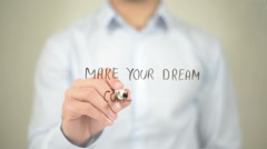 Make Your Dream Come True , Man writing on transparent screen Stock Footage