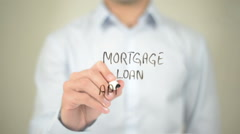 Mortgage Loan Approved , Man writing on transparent screen - stock footage