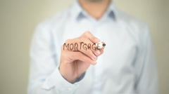 Mortgage Loan , Man writing on transparent screen Stock Footage