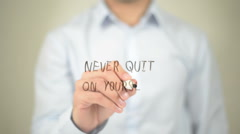 Never Quit on Yourself , Man writing on transparent screen - stock footage
