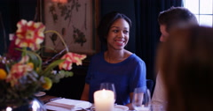 4k, Happy attractive couple looking at a menu while sitting at a restaurant Stock Footage