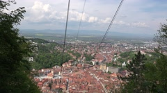BRASOV, ROMANIA - MAY 07, 2016:Cable car going up and down Stock Footage