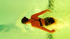 Slow motion shot of woman swimmer butterfly swimming from top angel of view Stock Footage