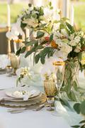 beautifully decorated table with flowers - stock photo