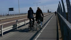STOCKHOLM: Bicyclists using the bike lane near the street road and sidewalk Stock Footage