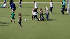 A large group of kids boys and girls playing football together-Running for ball - stock footage