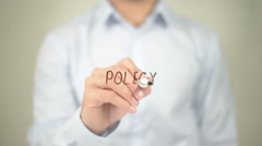 Policy , Man writing on transparent screen - stock footage