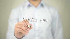 Policies and Procedures , Man writing on transparent screen Stock Footage