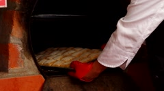 Fresh ciabattas breads coming out of stone oven, bakery concept Stock Footage