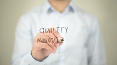 Quality Management , Man writing on transparent screen Stock Footage