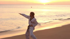 Silhouette of  sport student exercising martial arts in beach Stock Footage