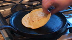 Corn Tortilla Cooked and Flipped in Hot Skillet Pan. Uncooked dough 4K Stock Footage