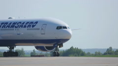 Boeing 777 taxiing on runway to the parking lot after landing Stock Footage