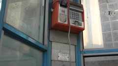 Vandalized, rusty payphone booth,receiver hanging, 4k, UHD Stock Footage