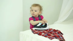 Little girl ironed shirt. - stock footage