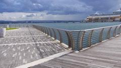 Pan to waterfront boardwalk bridge in San Juan Harbor. Stock Footage