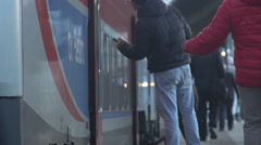 Passengers making haste to the train, the long-awaited journey, slow-motion Stock Footage