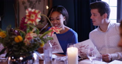 4k, Group of attractive people looking at their menu's at a fancy restaurant. Stock Footage