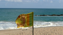 Srilankan flag at Tangalle beach Stock Footage