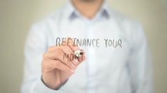 Refinance Your Mortgage, Man Writing on Transparent Screen - stock footage
