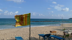 Srilankan flag and beach chairs Stock Footage