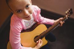 Girl playing the guitar Stock Photos